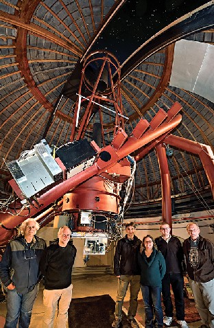 A telescope at California's Lick Observatory (with SETI's Dan Werthimer, second from left) will look for lasers. (Laurie Hatch)